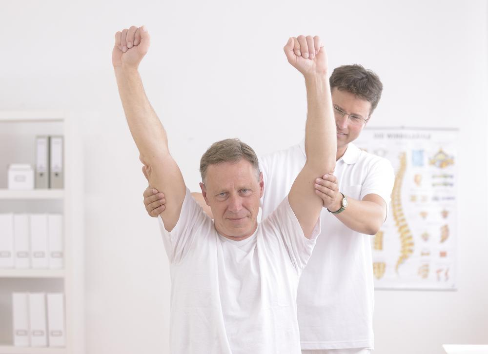 man receiving chiropractic care in elkridge,md